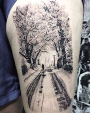 Tattoo of a snowy scene photograph